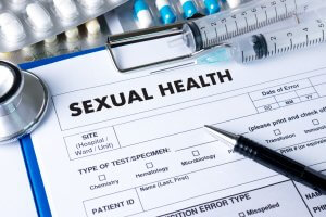 sexual health form clipped to a clipboard